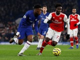 Chelsea's Callum Hudson-Odoi and Arsenal's Bukayo Saka compete for the ball in the Premier League on January 21, 2020.