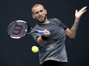 Australian Open day one: Evans, Federer, Djokovic, Serena all through