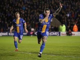 Shrewsbury Town's Jason Cummings celebrates scoring their first goal from the penalty spot on January 26, 2020