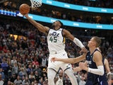 Utah Jazz guard Donovan Mitchell (45) lifts the ball to the basket during the fourth quarter against the Dallas Mavericks at Vivint Smart Home Arena on January 26, 2020