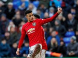 Manchester United's Mason Greenwood celebrates scoring their sixth goal from the penalty spot on January 26, 2020