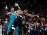 Milwaukee Bucks' Giannis Antetokounmpo in action with Charlotte Hornets' Miles Bridges on January 24, 2020