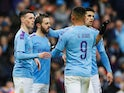 Manchester City's Bernardo Silva celebrates scoring their second goal with teammates on January 26, 2020