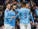 Manchester City's Bernardo Silva celebrates scoring their second goal with teammates on January 26, 2020