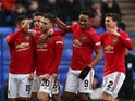 Manchester United's Diogo Dalot celebrates scoring their second goal with teammates on January 26, 2020