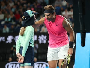 Rafael Nadal apologises with a kiss after hitting ball girl