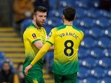 Norwich City's Grant Hanley celebrates scoring their first goal with Mario Vrancic on January 25, 2020