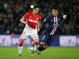 Monaco's Wissam Ben Yedder in action with Paris Saint-Germain's Thiago Silva on January 12, 2020