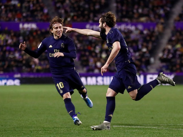 Real Madrid's Nacho celebrates scoring their first goal with Luka Modric on January 26, 2020