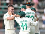 South Africa's Dane Paterson celebrates with teammates after taking the wicket of England's Joe Denly on January 24, 2020