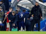 Chelsea's Tammy Abraham is helped down the tunnel after sustaining an injury at the end of the match on January 21, 2020