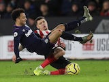 Sheffield United's Muhamed Besic in action with West Ham United's Felipe Anderson on January 10, 2020