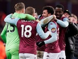 Aston Villa's Trezeguet celebrates after the match with Matt Targett, Orjan Nyland, teammates and fans on the pitch on January 28, 2020