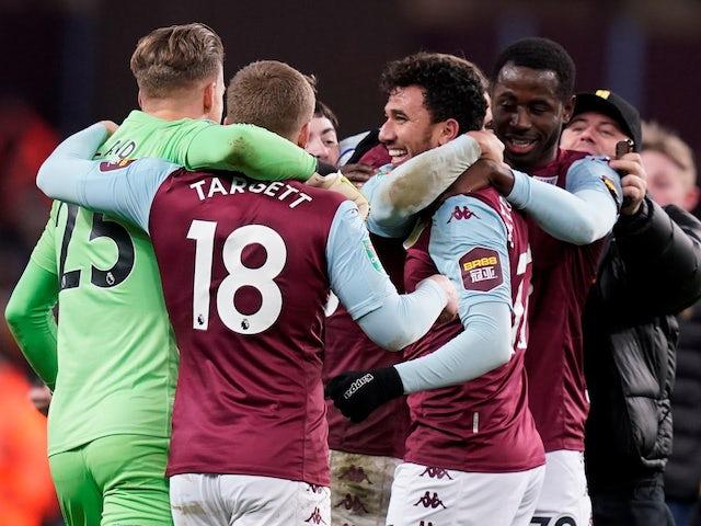 Aston Villa's Trezeguet celebrates after the match with Matt Targett, Orjan Nyland, teammates and fans on the pitch on January 28, 2020