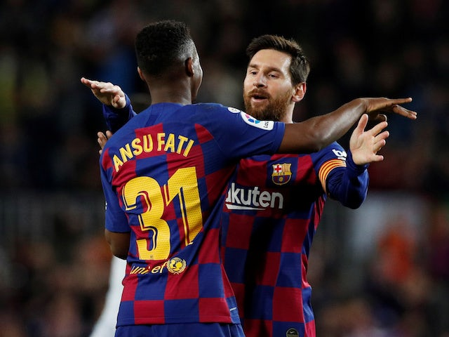 Barcelona's Anssumane 'Ansu' Fati celebrates scoring their first goal with Lionel Messi on February 2, 2020