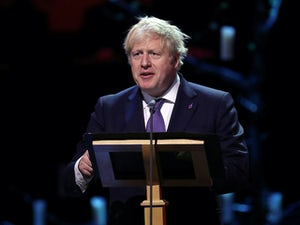 "Boris Johnson ""improving"" and ""sitting up in bed"""