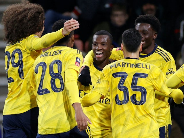 Eddie Nketiah celebrates scoring his side's second with Arsenal teammates on January 27, 2020