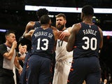 Memphis Grizzlies center Jonas Valanciunas (17) and New York Knicks forward Marcus Morris Sr. (13) and forward Julius Randle (30) push and shove during an altercation during the second half at Madison Square Garden on January 30, 2020