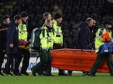 Huddersfield's Kamil Grabara is stretchered off after sustaining an injury on January 28, 2020