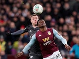 Leicester City's Jamie Vardy in action with Aston Villa's Kortney Hause on January 29, 2020