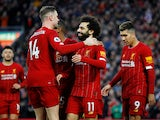 Liverpool's Mohamed Salah celebrates scoring their third goal with Jordan Henderson and teammates on February 1, 2020