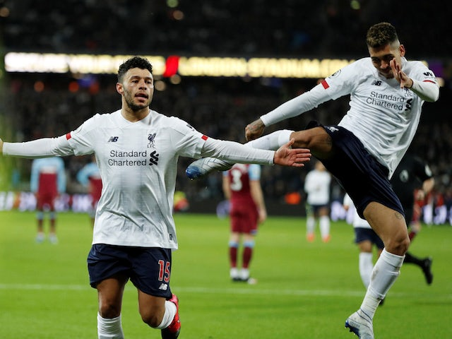 Liverpool's Alex Oxlade-Chamberlain celebrates scoring their second goal with Roberto Firmino on January 29, 2020