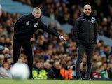Manchester United manager Ole Gunnar Solskjaer reacts as Manchester City manager Pep Guardiola looks on on January 29, 2020