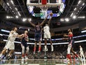 Milwaukee Bucks forward Khris Middleton (22) shoots against Washington Wizards center Thomas Bryant (13) during the fourth quarter at Fiserv Forum on January 29, 2020