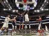 Milwaukee Bucks forward Khris Middleton (22) shoots against Washington Wizards center Thomas Bryant (13) during the fourth quarter at Fiserv Forum on January 29, 2020