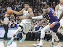 Milwaukee Bucks forward Giannis Antetokounmpo (34) drives past Phoenix Suns center Deandre Ayton (22) in the fourth quarter at Fiserv Forum on February 2, 2020