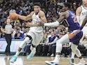 Milwaukee Bucks forward Giannis Antetokounmpo (34) drives past Phoenix Suns center Deandre Ayton (22) in the fourth quarter at Fiserv Forum on February 2, 2020