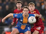 Shrewsbury Town's David Edwards in action with Liverpool's Jake Cain on February 5, 2020