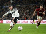 Derby County's Wayne Rooney scores their fourth goal from the penalty spot on February 4, 2020