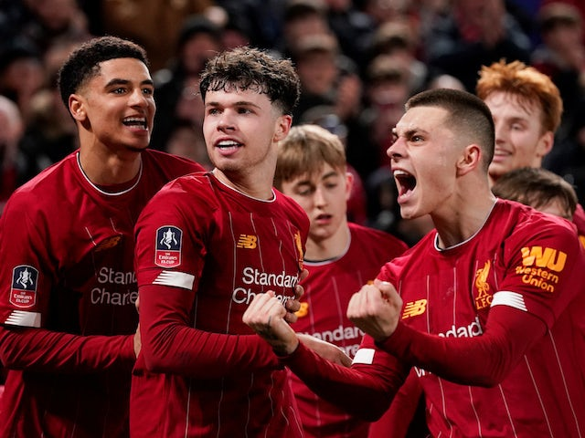 Liverpool's Neco Williams celebrates with team mates after Shrewsbury Town's Ro-Shaun Williams scored an own goal and the first for Liverpool on February 4, 2020