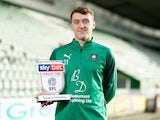 Luke Jephcott poses with his League Two Player of the Month award for January 2020