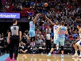 Miami Heat forward Jimmy Butler (22) shoots over Philadelphia 76ers forward Al Horford (42) during the second half at American Airlines Arena on February 4, 2020