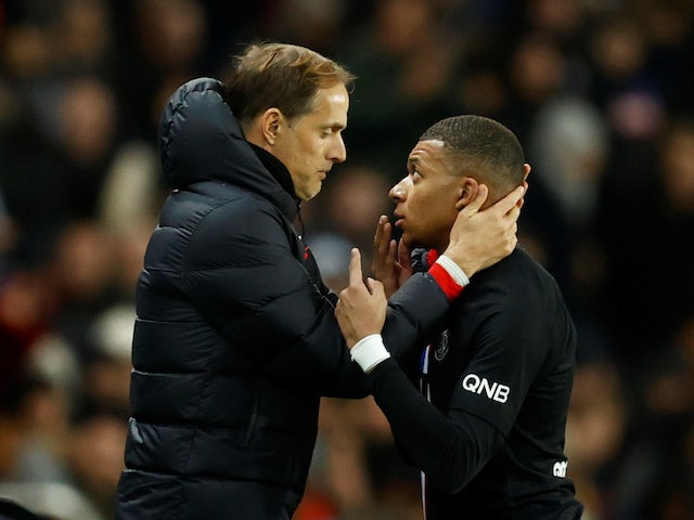 Paris St Germain's Kylian Mbappe speaks to coach Thomas Tuchel as he comes off as a substitute in February 2020