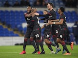 Reading's Sone Aluko celebrates with team mates after winning the penalty shootout on February 4, 2020