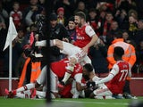 Arsenal's Alexandre Lacazette celebrates scoring their fourth goal with Shkodran Mustafi, Pierre-Emerick Aubameyang, Bukayo Saka and teammates on February 16, 2020