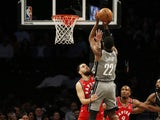 Brooklyn Nets guard Caris LeVert (22) shoots over Toronto Raptors guard Fred VanVleet (23) during the first half at Barclays Center on February 13, 2020