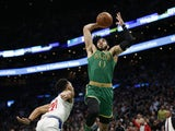 Boston Celtics forward Jayson Tatum (0) prepares to dunk over Los Angeles Clippers point guard Landry Shamet (20) during the second half at TD Garden on February 14, 2020