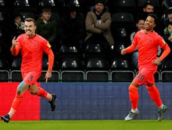 Huddersfield Town's Harry Toffolo celebrates scoring their first goal with Chris Willock on February 15, 2020