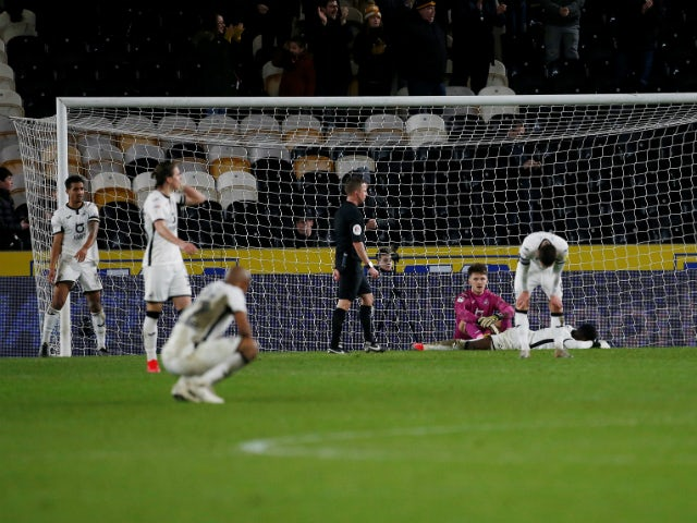 Swansea City's players look dejected after conceding a fourth goal in their 4-4 draw with Hull City on February 14, 2020