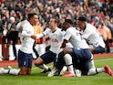 Tottenham Hotspur's Son Heung-min celebrates scoring their third goal with Gedson Fernandes and teammates on February 16, 2020