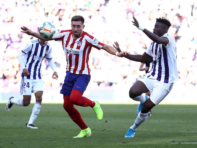 Atletico Madrid's Hector Herrera in action with Real Valladolid's Mohammed Salisu in La Liga on October 6, 2019