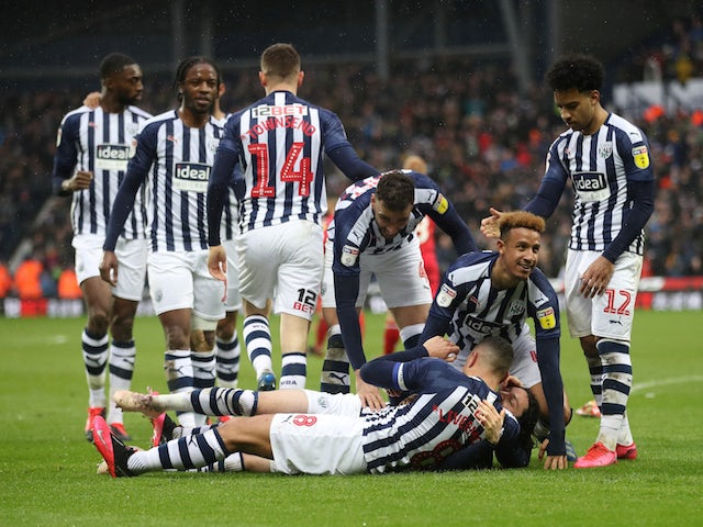 West Bromwich Albion players celebrate after Nottingham Forest's Tobias Figueiredo scored an own goal and their second goal on February 15, 2020