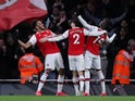 Arsenal's Pierre-Emerick Aubameyang celebrates scoring their third goal with Nicolas Pepe and Hector Bellerin on February 23, 2020