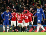 Harry Maguire is mobbed after scoring Manchester United's second goal against Chelsea on February 17, 2020