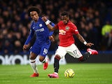 Chelsea's Willian in action with Manchester United's Fred in the Premier League on February 17, 2020
