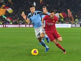 Lazio's Joaquin Correa in action with AS Roma's Bryan Cristante in Serie A on January 26, 2020